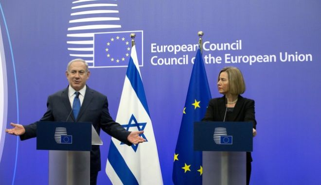 European Union High Representative Federica Mogherini, right, and Israeli Prime Minister Benjamin Netanyahu address a media conference at the EU Council building in Brussels on Monday, Dec. 11, 2017. (AP Photo/Virginia Mayo)