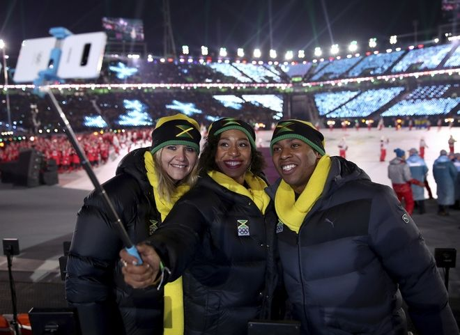 Athletes from Jamaica take a selfie during the opening ceremony of the 2018 Winter Olympics in Pyeongchang, South Korea, Friday, Feb. 9, 2018. (Clive Mason/Pool Photo via AP)