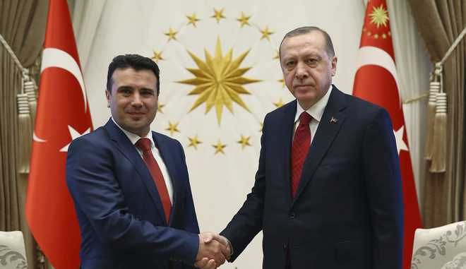 Turkey's President Recep Tayyip Erdogan, right, and Macedonia's Prime Minister Zoran Zaev shake hands before a meeting in Ankara, Turkey, Monday, Feb. 12, 2018. Zaev is in Turkey for an official visit. (Pool Photo via AP)