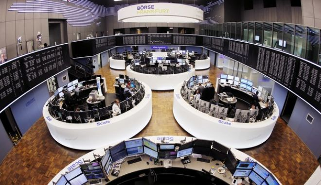 """FILE - In this  March 27, 2017 file photo, a general view of the trading room at the German stock market pictured in Frankfurt, Germany. The European Union blocked the proposed merger of Germany's Deutsche Boerse and the London Stock Exchange on Wednesday, March 29, 2017 saying that it had """"very serious"""" concerns about the deal's impact on competition. (AP Photo/Michael Probst,file)"""