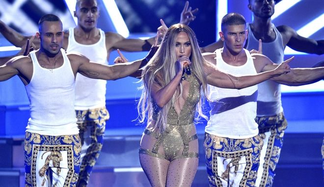 Video Vanguard award winner Jennifer Lopez, center, performs at the MTV Video Music Awards at Radio City Music Hall on Monday, Aug. 20, 2018, in New York. (Photo by Chris Pizzello/Invision/AP)
