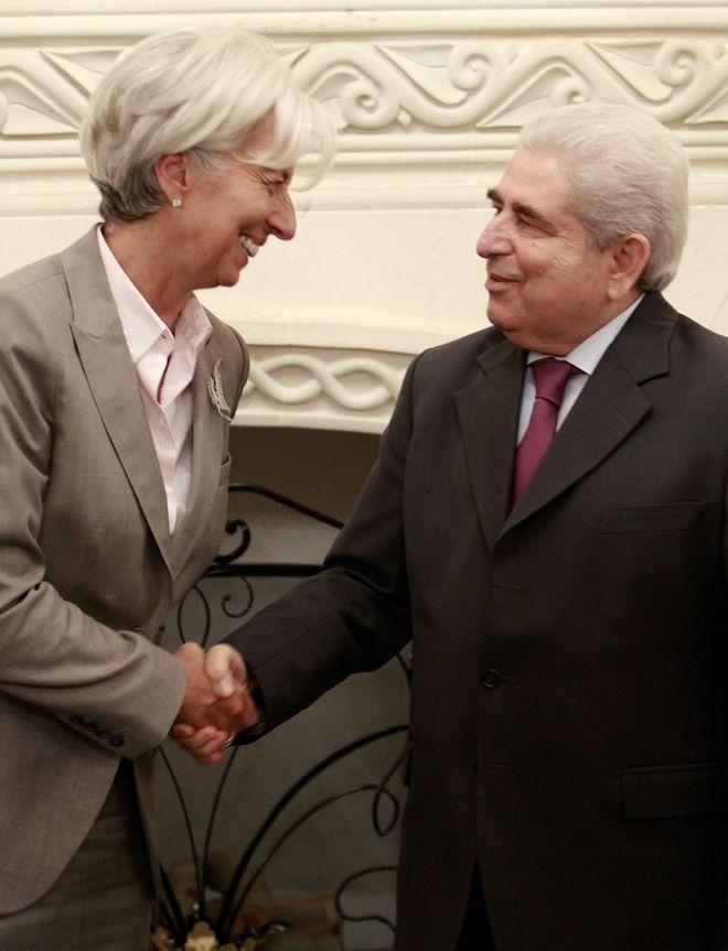 Δημήτρης Χριστόφιας και Κριστίν Λαγκάρντ στη Λευκωσία στην Κύπρο (AP Photo/Petros Karadjias)