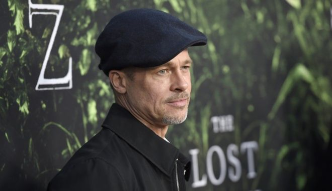 """Brad Pitt arrives at the Los Angeles premiere of """"The Lost City of Z"""" at the ArcLight Hollywood on Wednesday, April 5, 2017. (Photo by Chris Pizzello/Invision/AP)"""