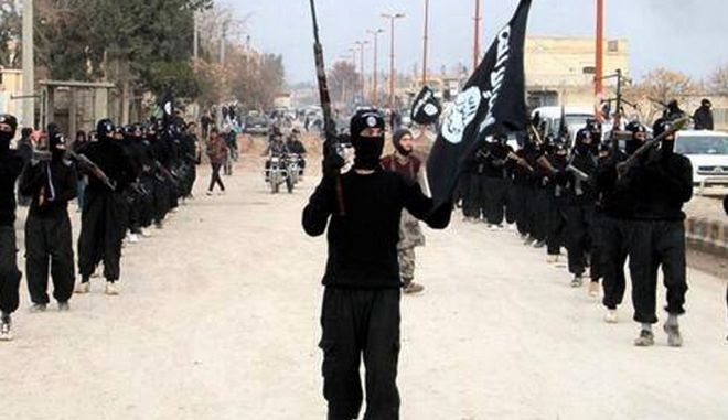 FILE - In this undated file image posted on a militant website on Tuesday, Jan. 14, 2014, which has been verified and is consistent with other AP reporting, fighters from the Islamic State group march in Raqqa, Syria. The Islamic State group is often described as the most fearsome jihadi outfit of all: a global menace outweighing al-Qaida, with armies trembling before its advance. But while the group has been successful at seizing parts of Iraq and Syria, it is no unstoppable juggernaut. (AP Photo/Militant Website, File)