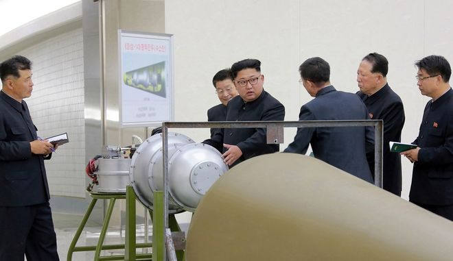 In this undated image distributed on Sunday, Sept. 3, 2017, by the North Korean government, shows North Korean leader Kim Jong Un at an undisclosed location. North Koreas state media on Sunday, Sept 3, 2017, said leader Kim Jong Un inspected the loading of a hydrogen bomb into a new intercontinental ballistic missile, a claim to technological mastery that some outside experts will doubt but that will raise already high worries on the Korean Peninsula. Independent journalists were not given access to cover the event depicted in this image distributed by the North Korean government. The content of this image is as provided and cannot be independently verified. (Korean Central News Agency/Korea News Service via AP)