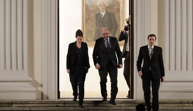 Social Democratic Party, SPD chairman Martin Schulz, centre, leaves Bellevue palace after he attends talks with German President Frank-Walter Steinmeier about a new German government in Berlin, Thursday, Nov. 30, 2017.  Political talks on Thursday are aimed at breaking the impasse over the formation of a new coalition government. (AP Photo/Markus Schreiber)