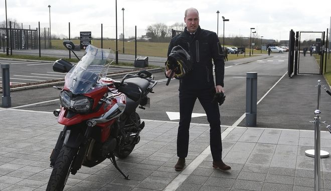 Britain's Prince William visits the Triumph Motorcycles and MIRA Technology Park in Hinckley, England, Tuesday Feb. 20, 2018. (Ian Vogler/Pool via AP)
