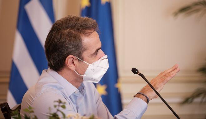 Ο πρωθυπουργός Κυριάκος Μητσοτάκης στη τηλεδιάσκεψη με αντικείμενο το σχέδιο για τον εμβολιασμό κατά του κορονοϊού  στην Ελλάδα και την εκστρατεία ενημέρωσης των πολιτών
