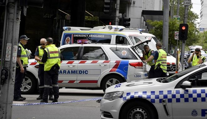 Police and rescue vehicles are parked after a car struck pedestrians in the central business district of Melbourne, Australia, Friday, Jan. 20, 2017. A man deliberately drove into a street crowded with pedestrians on Friday, killing people, police said. Officials said the incident had no links to terrorism. (AP Photo/Andrew Brownbill)