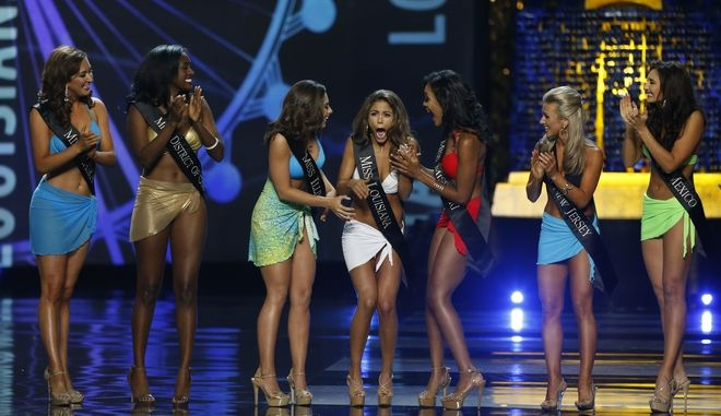 Miss Louisiana Laryssa Bonacquisti reacts after advancing to the evening gown round of the Miss America 2018 pageant, Sunday, Sept. 10, 2017, in Atlantic City, N.J. (AP Photo/ Noah K. Murray)