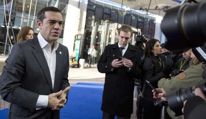 Greek Prime Minister Alexis Tsipras, left, speaks with the media as he arrives for an EU summit in Goteborg, Sweden on Friday, Nov. 17, 2017. European Union leaders warned Britain Friday that it must do much more to convince them that Brexit talks should be broadened to future relations and trade from December. (AP Photo/Virginia Mayo)
