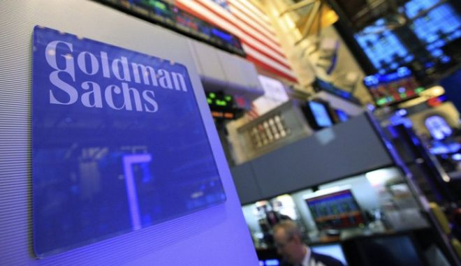A Goldman Sachs sign is seen on at the company's post on the floor of the New York Stock Exchange, January 18, 2012. Goldman Sachs Group Inc's fourth-quarter profit fell 56 percent as trading and investment banking revenue plunged, but the bank managed to beat analysts' expectations through cost cutting and lower taxes. REUTERS/Brendan McDermid (UNITED STATES - Tags: BUSINESS)