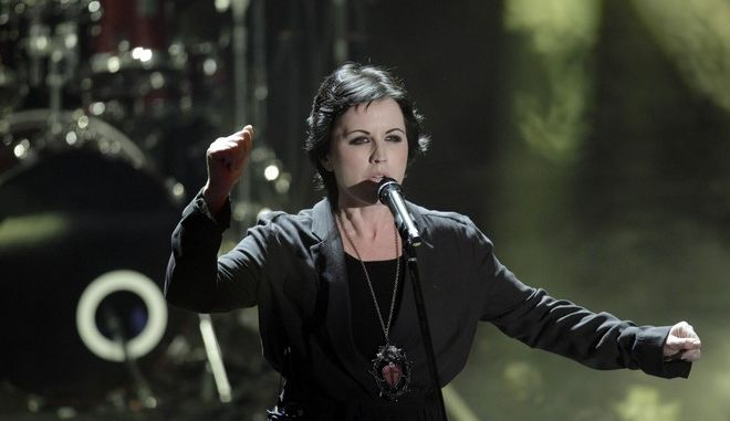 Dolores O'Riordan, frontwoman of Irish softrock group Cranberries performs during the 62nd edition of the Sanremo Song Festival, in Sanremo, Italy, Saturday, Feb. 18, 2012. (AP Photo/Luca Bruno)