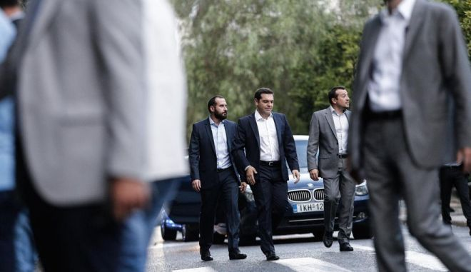 The greek Prime Minister Alexis Tsipras enters the presidential mansion for a meeting with the greek president Prokopis Pavlopoulos in order to recieve the governing order after SYRIZA party`s victory at the latest elections, in Athens, on Sept. 21, 2015 /                    ,              ,  ,  21 , 2015