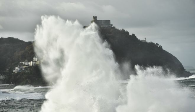 Giant waves crash against the sea defenses of the city during a high tide in San Sebastian, northern Spain, Friday, Dec.15, 2017. Spain suffers new high winds and heavy rain as a storm reaches the northern of Iberian Peninsula from the Atlantic. (AP Photo/Alvaro Barrientos)