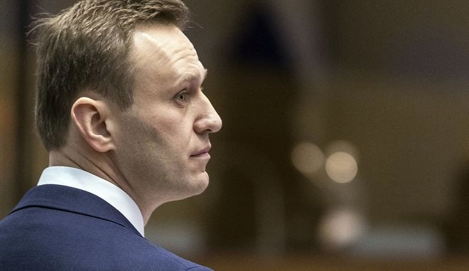Russian opposition activist Alexei Navalny stands prior to a hearing at the European Court of Human Rights in Strasbourg, eastern France. Wednesday, Jan. 24, 2018. Russian opposition leader Alexei Navalny is at the European court for a hearing into whether Russian authorities violated his rights through numerous arrests. (AP Photo/Jean-Francois Badias)
