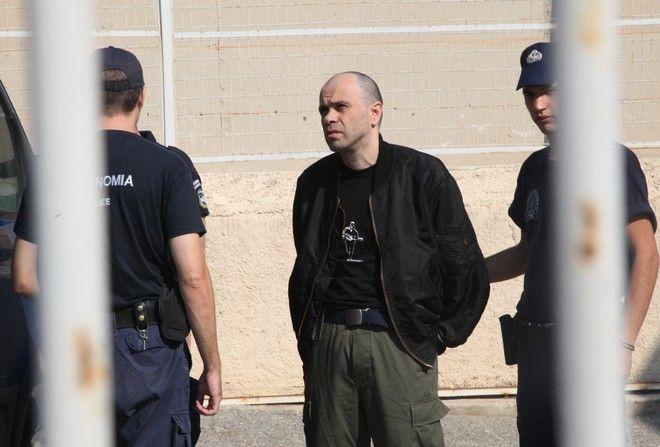 5-10-2011-Ξεκινά σήμερα στην ειδικά διαμορφωμένη αίθουσα των φυλακών Κορυδαλλού η δίκη για την υπόθεση της οργάνωσης του Επαναστατικού Αγώνα// ΣΤΗ ΦΩΤΟΓΡΑΦΙΑ Ο ΚΑΤΗΓΟΡΟΥΜΕΝΟΣ ΝΙΚΟΣ ΜΑΖΙΩΤΗΣ .(EUROKINISSI-ΓΙΑΝΗΣ ΠΑΝΑΓΟΠΟΥΛΟΣ)