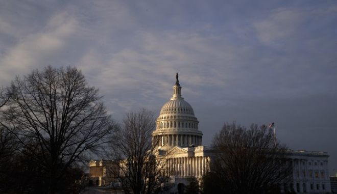 The Capitol is seen at sunup, Friday, Feb. 17, 2017, as Senate Republicans are poised to use their majority to confirm President Donald Trump's controversial nominee to lead the Environmental Protection Agency, despite calls from Democrats for a delay as both houses of Congress prepare to leave Washington for the President's Day weekend and return to their home districts. The Senate remains tied up with delays in confirming Trump's cabinet picks, while the House is spending most of its time reversing regulations from the close of President Obama's president's term, including the GOP's promised swift repeal of Obamacare. (AP Photo/J. Scott Applewhite)
