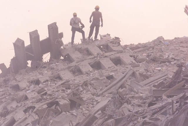 late afternoon at World Trade Center disaster.  Rescue workers on rubble.    ground zero