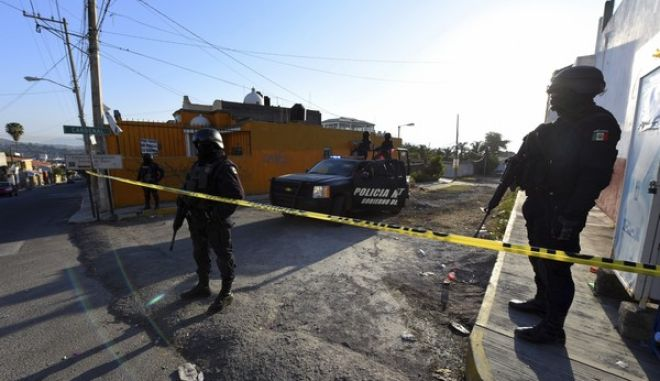 State police guard the area after a gun battle with Mexican Marines in which a suspect identified by authorities as the leader of the Beltran Leyva cartel, Juan Francisco Patron Sanchez and several accomplices died in the exchange, in Tepic, Nayarit state, Mexico, Friday, Feb. 10, 2017. The Interior Department said that Juan Francisco Patron Sanchez headed up the cartel's operations in the state of Nayarit and in the southern part of Jalisco state. (AP Photo/Chris Arias)