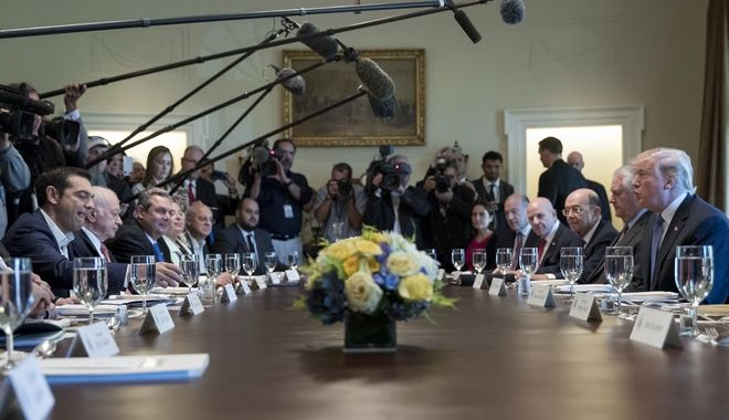 President Donald Trump, right, and Greek Prime Minister Alexis Tsipras, left, participate in a working lunch in the Cabinet Room of the White House in Washington, Tuesday, Oct. 17, 2017. (AP Photo/Carolyn Kaster)