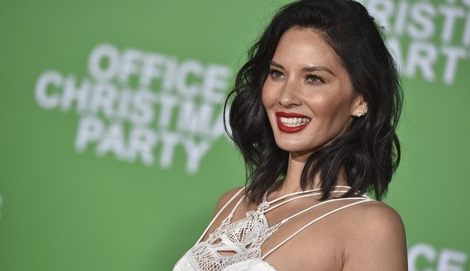 "Olivia Munn arrives at the Los Angeles premiere of ""Office Christmas Party"" at the Village Theatre Westwood on Wednesday, Dec. 7, 2016. (Photo by Jordan Strauss/Invision/AP)"