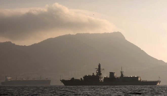 FILE - In this file photo dated Monday Aug. 19, 2013, Britain's Royal Navy ship HMS Westminster, right, sails along the Gibraltar stretch backdropped by the tiny territory on the southern tip of the Iberian peninsula the rock of Gibraltar, near to La Linea de la Concepcion, Spain.  Fabian Picardo, the chief minister of the tiny British territory, said Sunday May 29, 2016, that Gibraltar could find its access to the single European market blocked by a hostile Spanish government if the United Kingdom votes to leave the European Union in their upcoming referendum next month. (AP Photo/Laura Leon, FILE)