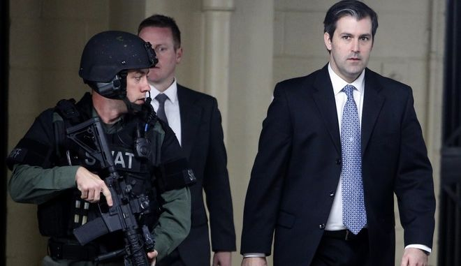 FILE - In this Dec. 5, 2016, file photo, Michael Slager, right, walks from the Charleston County Courthouse under the protection from the Charleston County Sheriff's Department after a mistrial was declared for his trial in Charleston, S.C. When nine black churchgoers in Charleston were massacred by Dylann Roof, a white man with Confederate sympathies, the city stayed calm and the victims families offered examples of grace and forgiveness. Roofs guilty verdict came less than two weeks after a jury deadlocked in the case of Slager, a white ex-police officer charged with fatally shooting Walter Scott, a black man, as Scott tried to flee an April 2015 traffic stop. (AP Photo/Mic Smith, File)