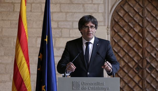 Catalan President Carles Puigdemont makes a statement at the Palau Generalitat in Barcelona, Spain,Thursday Oct. 26, 2017. he Puigdemont, the leader of Spain's secession-minded Catalonia region says he has decided against calling a parliamentary election that might have defused tension with the Spanish government. (AP Photo/Emilio Morenatti)