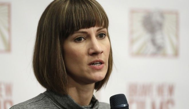 FILE - In this Dec. 11, 2017, file photo, Rachel Crooks, a university administrator and former Trump Tower receptionist, discusses her sexual misconduct accusations against Donald Trump during a news conference with two other accusers in New York. Crooks filed paperwork Monday, Feb. 5, 2018, to run for Ohio's state legislature as a Democrat in northwest Ohio's 88th House District near Toledo and Lake Erie. If Crooks wins the primary, the first-time candidate would face incumbent Republican Bill Reineke, a car dealer serving his second term in office. (AP Photo/Mark Lennihan, File)