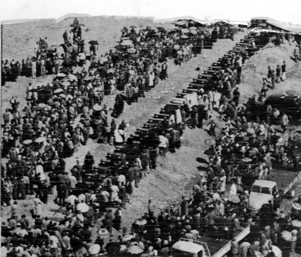 As black South Africans massed and demonstrated against South Africa's apartheid policies and the arrest of their leaders, 34 of the scores of blacks killed at Sharpeville, South Africa, were buried there on March 30, 1960. This aerial view shows row of caskets and the crowd at mass burial. (AP Photo)