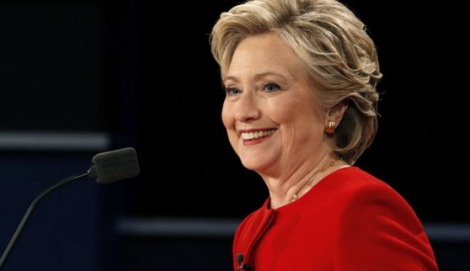 Democratic U.S. presidential nominee Hillary Clinton smiles during the first presidential debate with Republican U.S. presidential nominee Donald Trump at Hofstra University in Hempstead, New York, U.S., September 26, 2016.  REUTERS/Lucas Jackson