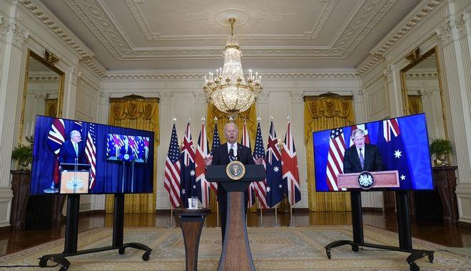 Οι Τζο Μπάιντεν, Μπόρις Τζόνσον και Σκοτ Μόρισον κατά την ανακοίνωση της συμφωνίας AUKUS