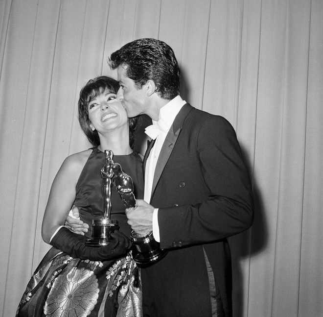 Rita Moreno gets a kiss from dancer and actor George Chakiris after they each won Academy Awards in Santa Monica, April 9, 1962. He was named best supporting actor and she was named best supporting actress of the year for their respective roles in