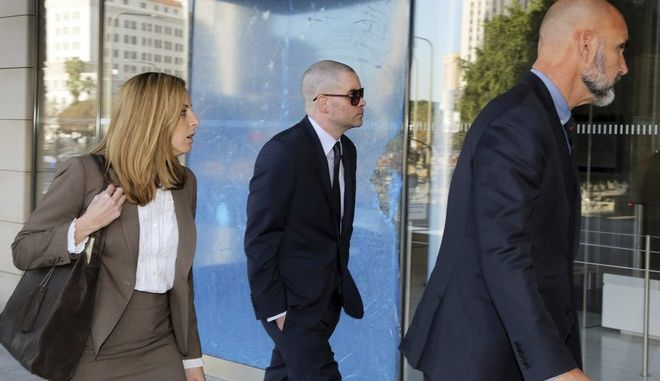 "Former ""Glee"" actor Mark Salling, center, arrives at federal court in Los Angeles on Monday, Dec. 18, 2017. Salling has pleaded guilty to possession of child pornography. (AP Photo/Reed Saxon)"