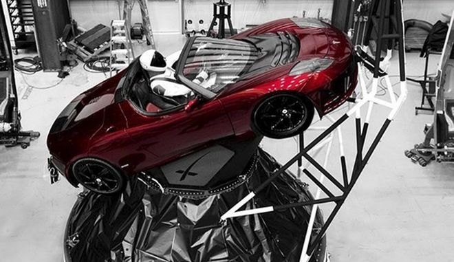 A mannequin Starman sits at the wheel of a Tesla Roadster in this photo posted on the Instagram account of Elon Musk, head of auto company Tesla and founder of the private space company SpaceX. The car will be on board when SpaceX launches its new rocket, the Falcon Heavy, from Kennedy Space Center at Cape Canaveral, Fla., scheduled for Tuesday, Feb. 6, 2018. (Courtesy of Elon Musk/Instagram via AP)