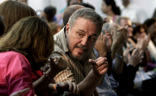 FILE - In this March 14, 2012 file photo, Fidel Castro Diaz-Balart, son of then Cuban leader Fidel Castro, speaks with an unidentified woman during the presentation of his father's book