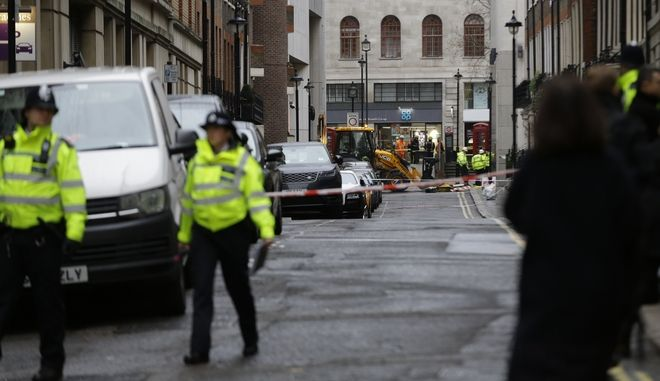 Police cordon off the area beside a major gas leak near Charing Cross railway station in central London, Tuesday, Jan. 23, 2018. Firefighters have closed Charing Cross railway station in central London and evacuated the surrounding area after the discovery of a natural gas leak. (AP Photo/Alastair Grant)