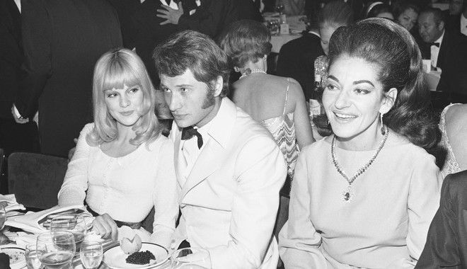 Pop singers Johnny Hallyday and his wife, Sylvie Vartan at left, are shown with Opera singer Maria Callas, Dec. 20, 1967 at the Lido in Paris. (AP Photo/Marqueton)