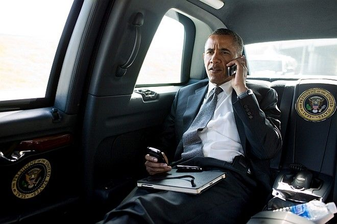 President Barack Obama talks on the phone with Aurora Mayor Steve Hogan during the motorcade ride to Palm Beach International Airport in Palm Beach, Fla., July 20, 2012. The President called Mayor Hogan to offer his condolences and support to the Aurora community. (Official White House Photo by Pete Souza)  This official White House photograph is being made available only for publication by news organizations and/or for personal use printing by the subject(s) of the photograph. The photograph may not be manipulated in any way and may not be used in commercial or political materials, advertisements, emails, products, promotions that in any way suggests approval or endorsement of the President, the First Family, or the White House.