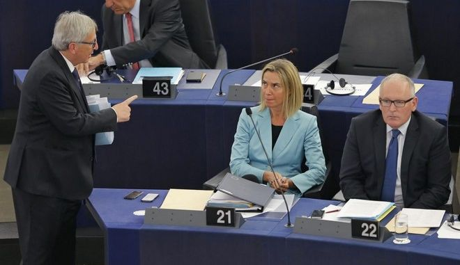 European Commission President Jean-Claude Juncker (L) gestures to European Union Foreign Policy Chief Federica Mogherini (C) and Vice-President of the European Commission Frans Timmermans, as he leaves after his address to the European Parliament in Strasbourg, France, September 9, 2015. European Commission President Juncker, urging Europeans to show humanity and dignity, said on Wednesday the EU executive would offer better protection for refugees but also improve its frontier defences and deport more illegal migrants.      REUTERS/Vincent Kessler