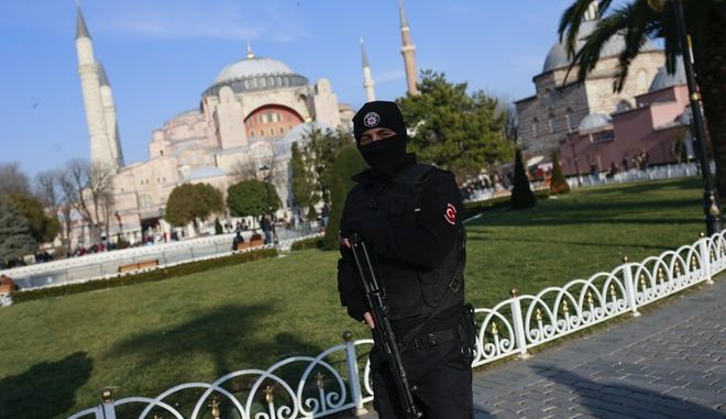 In this Wednesday Jan. 4, 2017 photo a Turkish police officer  patrols the area by the  Byzantine-era Hagia Sophia, one of Istanbul's main tourist attractions, in Istanbul. Turkey's economy is suffering in the face of a string of extremist attacks _ including this weeks nightclub massacre of New Years revelers, most of them foreigners _ and uncertainty following the failed coup in July against President Recep Tayyip Erdogan that saw more than 270 people killed. (AP Photo/ Emrah Gurel)