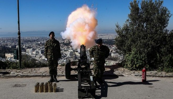 A greek artillery unit shoots 21 cannon shots, in honour of the 1821 Anniversary, from Lycabettus Hill, in Athens, on March 25, 2017 /      21  ,      25  1821,     ,  ,  25 , 2017