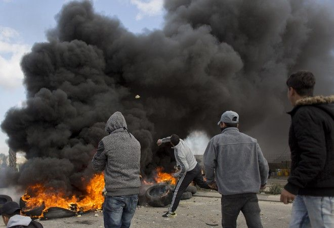 Palestinian protesters clash with Israeli troops following protests against U.S. President Donald Trump's decision to recognize Jerusalem as the capital of Israel, in the West Bank city of Ramallah, Thursday, Dec. 7, 2017. (AP Photo/Nasser Nasser)