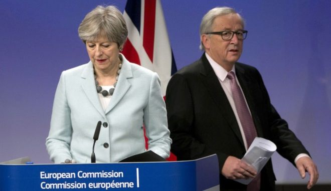 British Prime Minister Theresa May, left, an European Commission President Jean-Claude Juncker prepare to address a media conference at EU headquarters in Brussels on Friday, Dec. 8, 2017. British Prime Minister Theresa May, met with European Commission President Jean-Claude Juncker early Friday morning following crucial overnight talks on the issue of the Irish border.(AP Photo/Virginia Mayo)