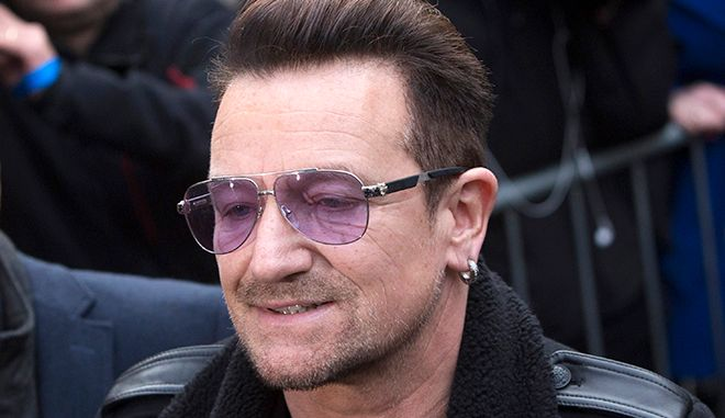 """U2 lead singer Bono arrives for the recording of the Band Aid 30 charity single in west London November 15, 2014. Singers came together to record a new version of the Band Aid charity song to raise money to combat Ebola in Africa. The single, """"Do They Know It's Christmas?"""", was first recorded 30 years ago after musician and philanthropist Bob Geldof inspired a host of stars to come together under the Band Aid name to help those affected by famine in Ethiopia.  REUTERS/Neil Hall (BRITAIN - Tags: ENTERTAINMENT SOCIETY HEALTH DISASTER) - RTR4E9F2"""