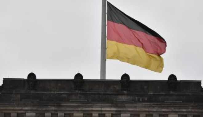 The German flag flies at halfmast at the Reichstag building that houses Germany's Bundestag lower house of parliament in Berlin, on May 24, 2017. At least 22 people died in Monday night's bombing attack on a Manchester pop concert, including an eight-year-old girl and several parents who had come to pick up their children. / AFP PHOTO / John MACDOUGALL        (Photo credit should read JOHN MACDOUGALL/AFP/Getty Images)
