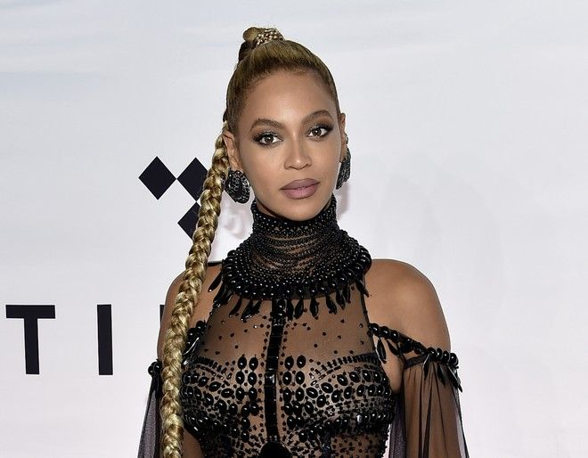 FILE - In this Oct. 15, 2016 file photo, singer Beyonce Knowles attends the Tidal X: 1015 benefit concert in New York.  Beyonce is nominated for Grammy Awards for best album, best song and record of the year. (Photo by Evan Agostini/Invision/AP, File)
