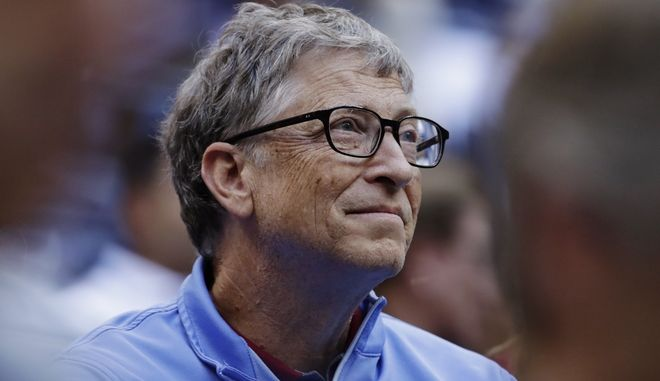 Microsoft founder Bill Gates watches play between Pablo Carreno Busta, of Spain, and Kevin Anderson, of South Africa, during the semifinals of the U.S. Open tennis tournament, Friday, Sept. 8, 2017, in New York. (AP Photo/Julio Cortez)