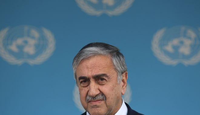 Turkish Cypriot leader Mustafa Akinci makes a statement to the media after a meeting with United Nations envoy Espen Barth Eide at the UN-controlled abandoned Nicosia airport in the divided island of Cyprus, Wednesday, Nov. 25, 2015. Eide says intensified talks aimed at reunifying ethnically divided Cyprus have yielded further progress and that the islands rival leaders are confident remaining issues can be resolved soon. (AP Photo/Petros Karadjias)